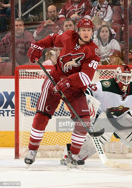 Rob Klinkhammer of the Phoenix Coyotes looks to deflect a shot on net against the Minnesota Wild at Jobingcom Arena on January 9 2014 in Glendale...