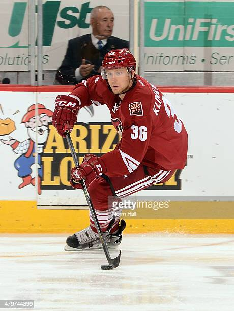 Rob Klinkhammer of the Phoenix Coyotes skates up ice with the puck against the Vancouver Canucks at Jobingcom Arena on March 4 2014 in Glendale...