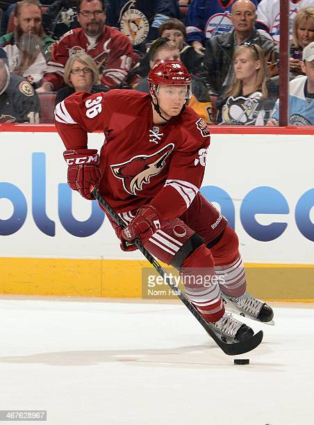 Rob Klinkhammer of the Phoenix Coyotes skates with the puck against the Pittsburgh Penguins at Jobingcom Arena on February 1 2014 in Glendale Arizona