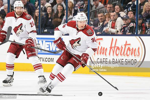 Rob Klinkhammer of the Phoenix Coyotes skates with the puck against the Columbus Blue Jackets on April 8 2014 at Nationwide Arena in Columbus Ohio