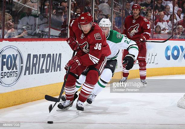 Rob Klinkhammer of the Phoenix Coyotes skates with the puck during the NHL game against the Dallas Stars at Jobingcom Arena on April 13 2014 in...