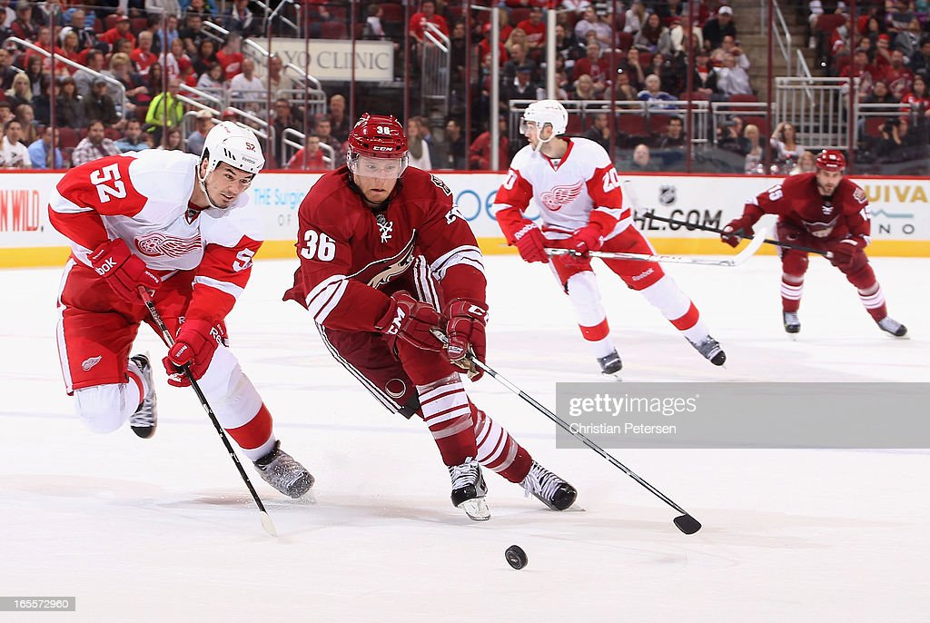 <a gi-track='captionPersonalityLinkClicked' href=/galleries/search?phrase=Rob+Klinkhammer&family=editorial&specificpeople=2127064 ng-click='$event.stopPropagation()'>Rob Klinkhammer</a> #36 of the Phoenix Coyotes skates with the puck past <a gi-track='captionPersonalityLinkClicked' href=/galleries/search?phrase=Jonathan+Ericsson&family=editorial&specificpeople=2538498 ng-click='$event.stopPropagation()'>Jonathan Ericsson</a> #52 of the Detroit Red Wings during the third period of the NHL game at Jobing.com Arena on April 4, 2013 in Glendale, Arizona. The Coyotes defeated the Red Wings 4-2.