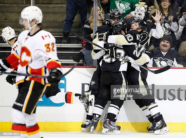 Rob Klinkhammer of the Pittsburgh Penguins celebrates with Steve Downie and Evgeni Malkin after scoring in the third period against the Calgary...