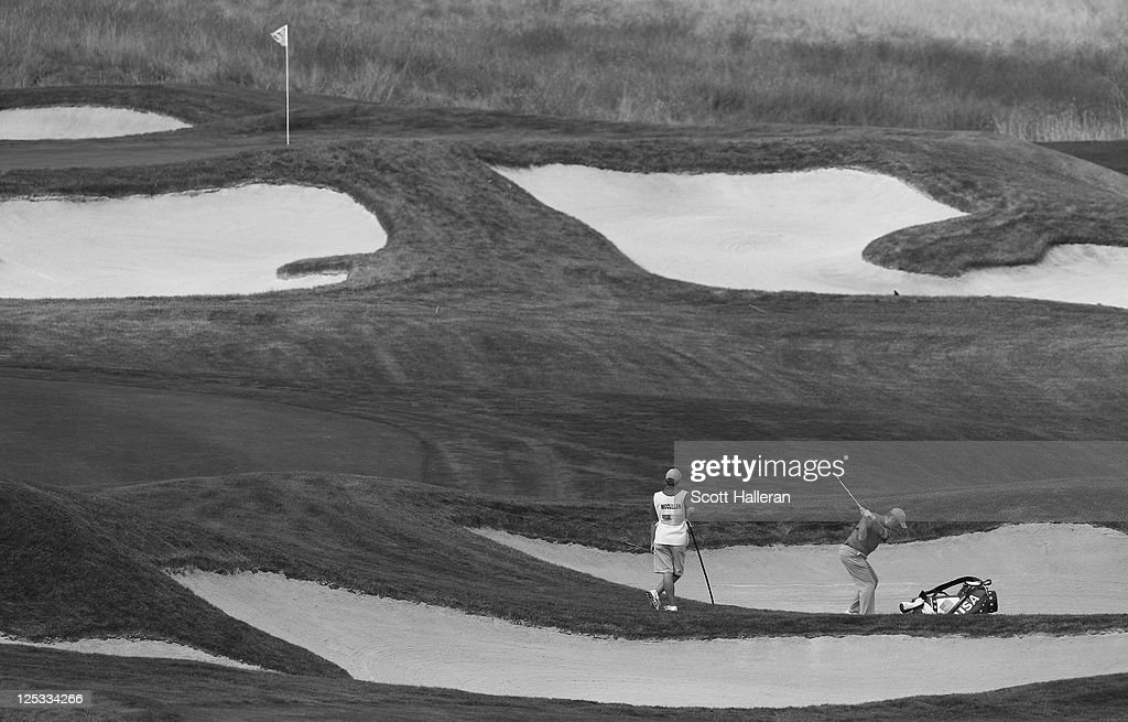 Rob McClellan of the USA team plays a shot as his caddie looks on during the Morning Four-Ball Matches at the 25th PGA Cup at the CordeValle Golf Club on September 16, 2011 in San Martin, California.