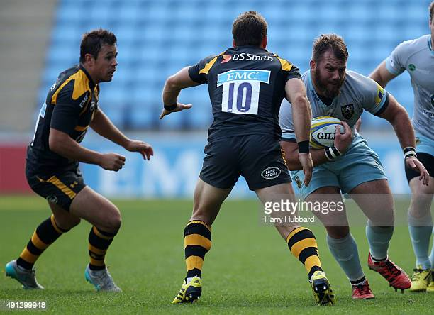 Rob Miller of Wasps and Jimmy Gopperth of Wasps and Gareth Denman of Northampton Saints in action during the pre season friendly match between Wasps...