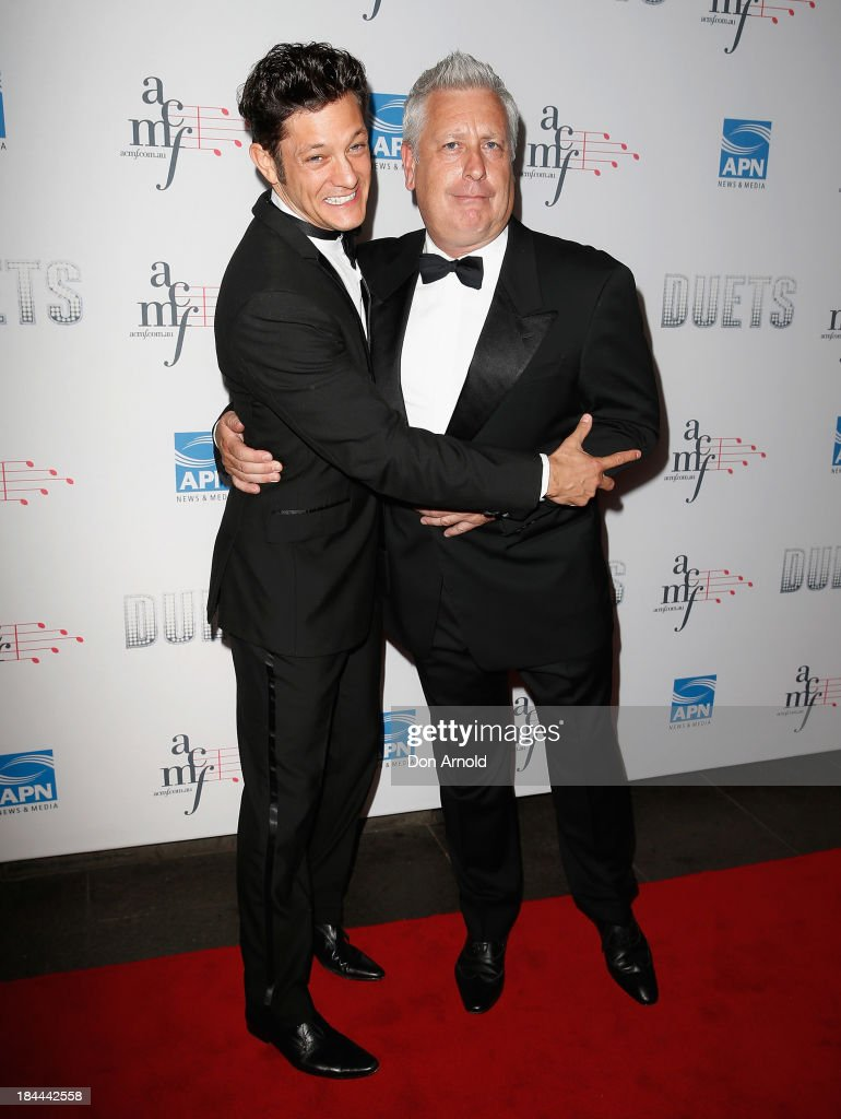 Rob Mills and Ian Dickson pose at the 4th Annual Duets Gala concert at the Capitol Theatre on October 14, 2013 in Sydney, Australia.