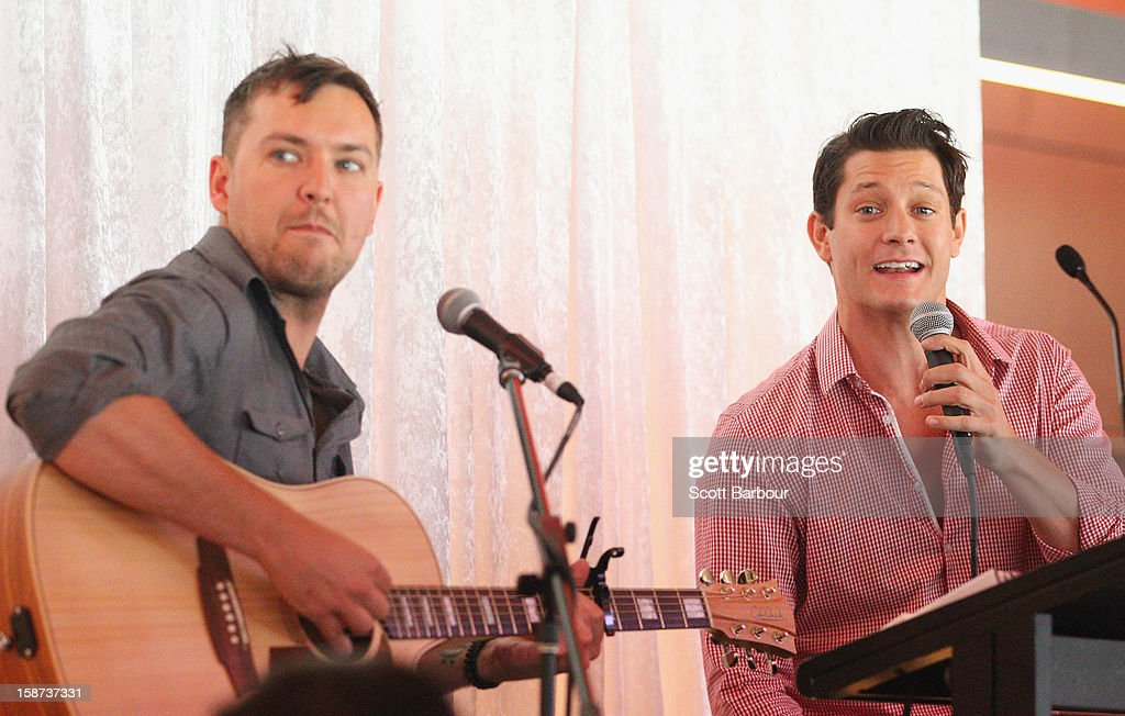 Rob Mills (R) performs during the 'High Tea at the G' luncheon on day two of the International Test match between Australia and Sri Lanka at Melbourne Cricket Ground on December 27, 2012 in Melbourne, Australia.