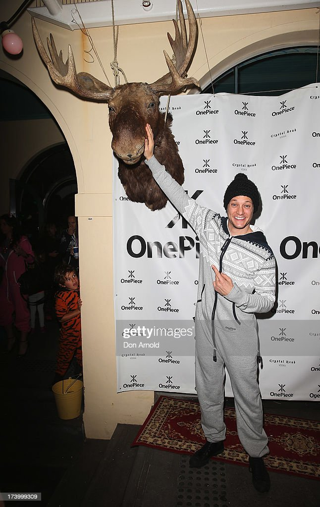 <a gi-track='captionPersonalityLinkClicked' href=/galleries/search?phrase=Rob+Mills+-+Musician&family=editorial&specificpeople=242952 ng-click='$event.stopPropagation()'>Rob Mills</a> poses during the OnePiece onesie Australian launch at the Bucket List at the Bondi Beach on July 19, 2013 in Sydney, Australia.