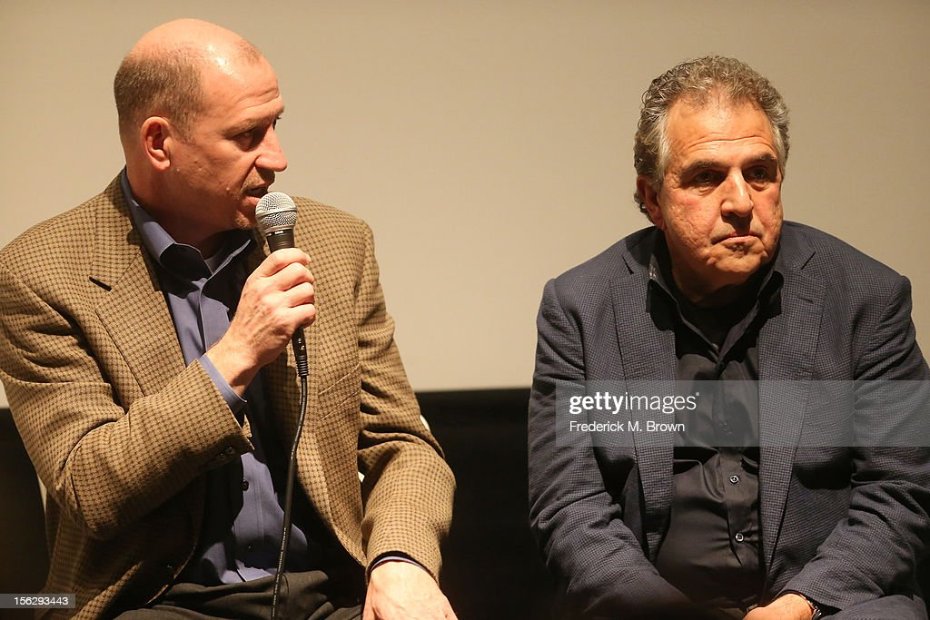 Rob Moore, Vice Chairman, Paramount Pictures Corporation (L), and Jim Gianopulos, Chairman 20th Century Fox Film, speak onstage during Deadline Hollywood's The Contenders at the Landmark Theater on November 10, 2012 in Los Angeles, California.