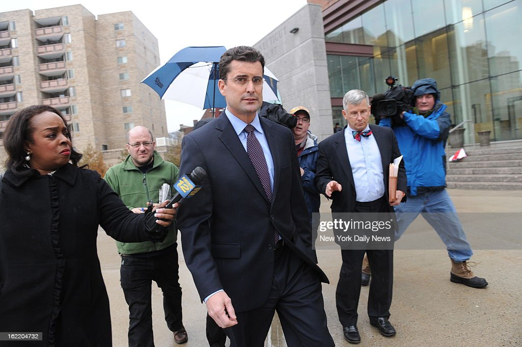 Rob Morrison arrives at court in Stamford, CT on Tuesday Feb. 19 to face charges of strangulation originating from an alleged domestic violence incident at his Darien, CT house. He still has a cut on his nose and his lip.