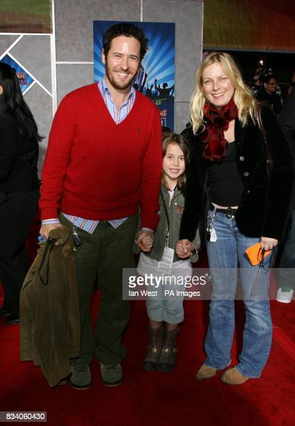 Rob Morrow with his wife Debbon Ayer and daughter Tu Simone Ayer Morrow arrive at the premiere for new film Hannah Montana and Miley CyrusBest of...