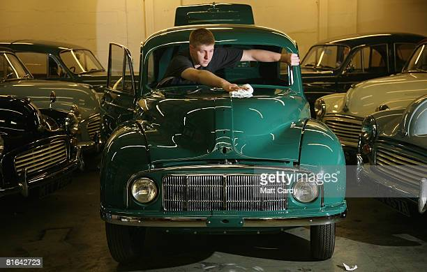 Rob Naish a car restorer at Charles Ware's Morris Minor Centre helps prepare a partly restored 60yearold 1948 Morris Minor which is being transported...