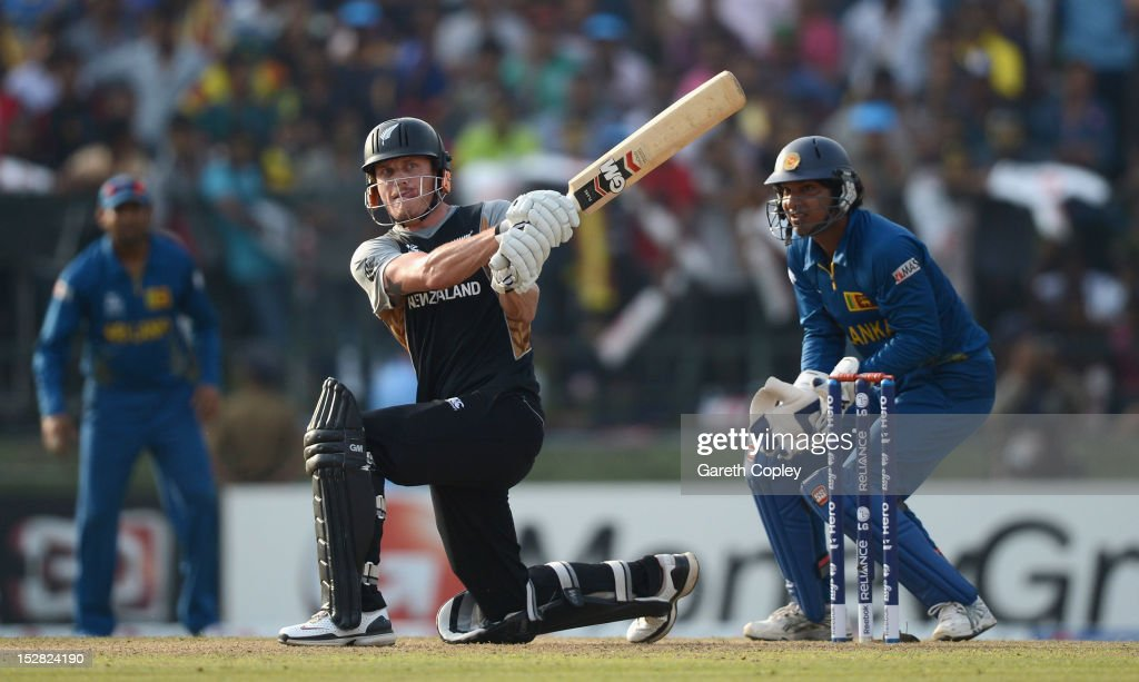 Rob Nicol of New Zealand hits out for six runs watched by Sri Lanka wicketkeeper <a gi-track='captionPersonalityLinkClicked' href=/galleries/search?phrase=Kumar+Sangakkara&family=editorial&specificpeople=206804 ng-click='$event.stopPropagation()'>Kumar Sangakkara</a> during the ICC World Twenty20 2012 Super Eights Group 1 match between Sri Lanka and New Zealand at Pallekele Cricket Stadium on September 27, 2012 in Kandy, Sri Lanka.