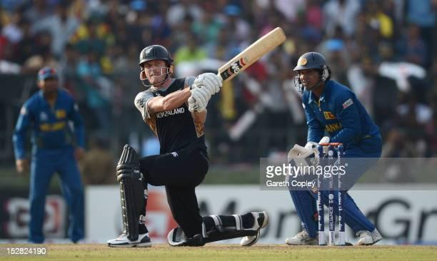 Rob Nicol of New Zealand hits out for six runs watched by Sri Lanka wicketkeeper Kumar Sangakkara during the ICC World Twenty20 2012 Super Eights...