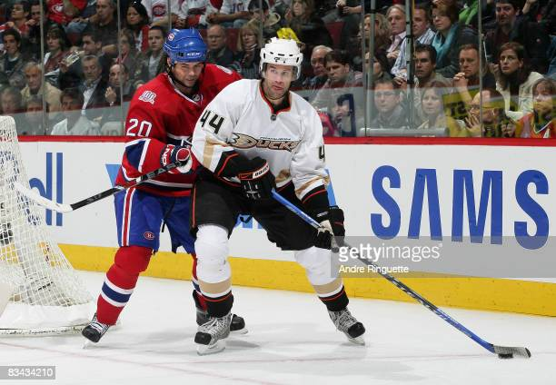 Rob Niedermayer of the Anaheim Ducks looks to pass as Robert Lang of the Montreal Canadiens checks at the Bell Centre on October 25 2008 in Montreal...