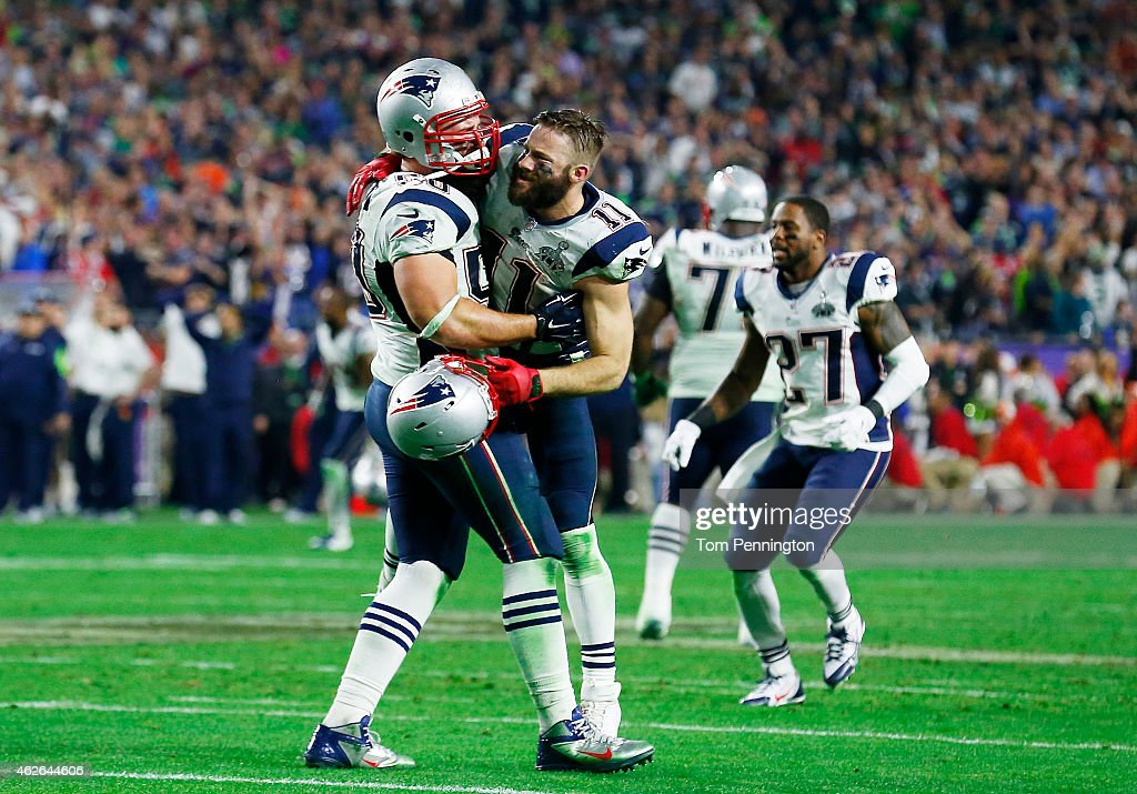 Rob Ninkovich and Julian Edelman of the New England Patriots celebrate after defeating the Seattle Seahawks 2824 to win Super Bowl XLIX at University...