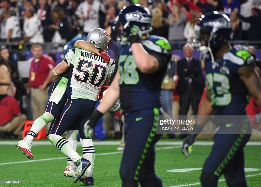Rob Ninkovich of the New England Patriots and teammates celebrates late in the fourth quarter against the Seattle Seahawks during Super Bowl XLIX...