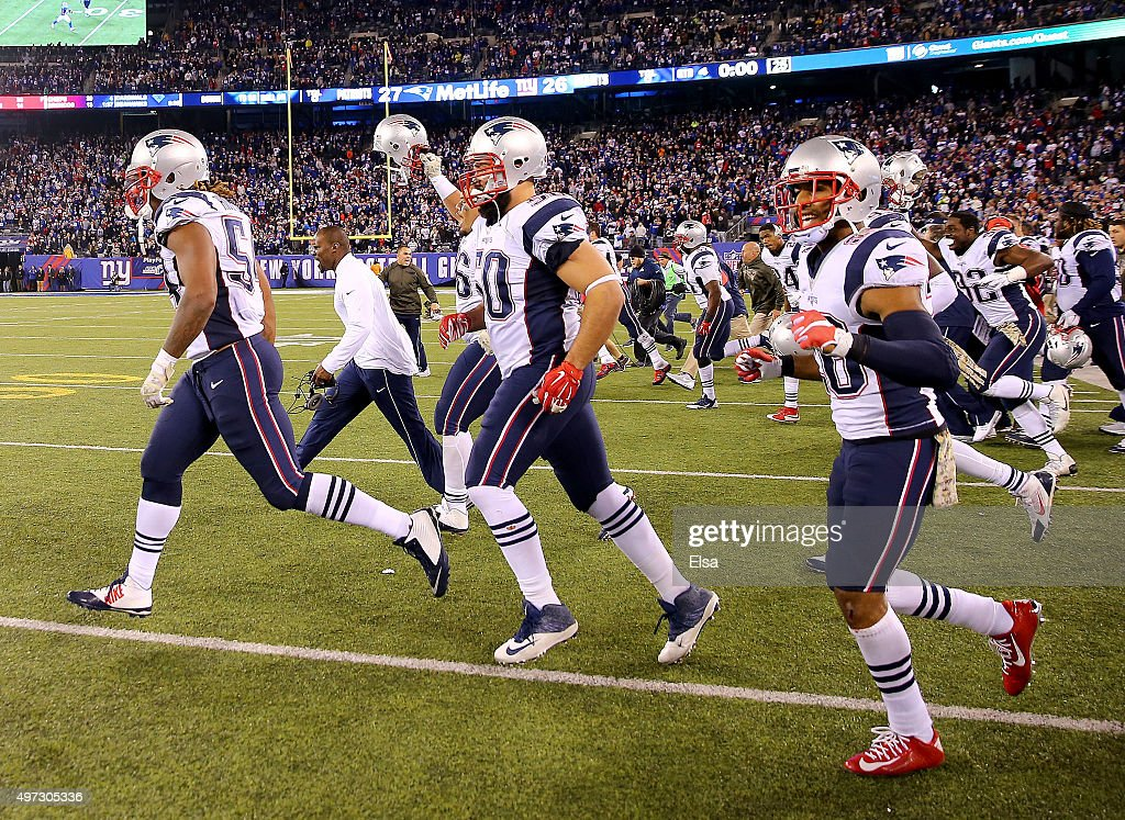 Rob Ninkovich #50 of the New England Patriots and the rest of his teammates celebrate the win over the New York Giants at MetLife Stadium on November 15, 2015 in East Rutherford, New Jersey.The New England Patriots defeated the New York Giants 27-26.