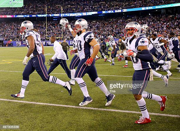 Rob Ninkovich of the New England Patriots and the rest of his teammates celebrate the win over the New York Giants at MetLife Stadium on November 15...