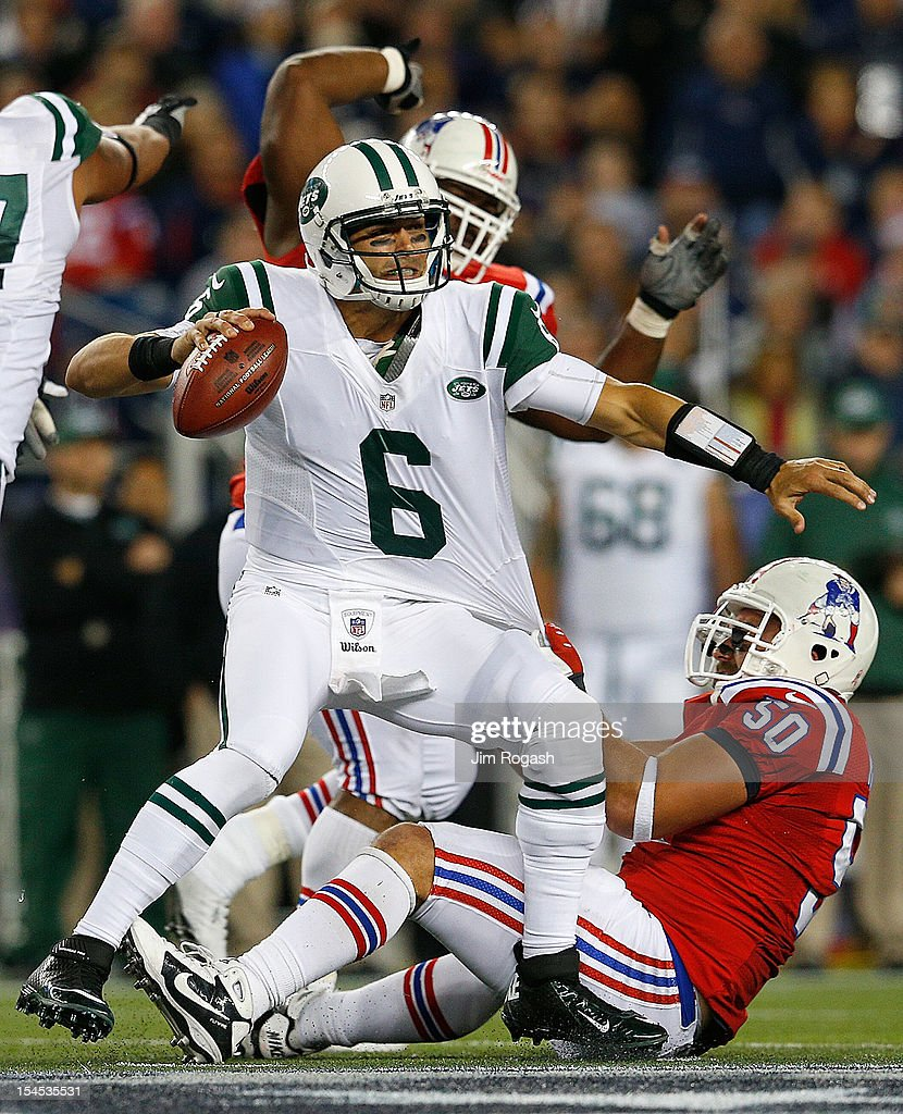 Rob Ninkovich of the New England Patriots brings down Mark Sanchez of the New York Jets in the fourth quarter at Gillette Stadium on October 21 2012...