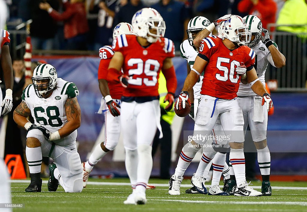 Rob Ninkovich of the New England Patriots celebrates after recovering the fumble that closed out their 2926 win against the New York Jets in overtime...