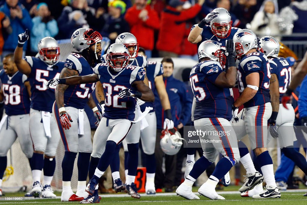 Rob Ninkovich #50 of the New England Patriots celebrates with his team after making an interception in the third quarter against the Houston Texans during the 2013 AFC Divisional Playoffs game at Gillette Stadium on January 13, 2013 in Foxboro, Massachusetts.