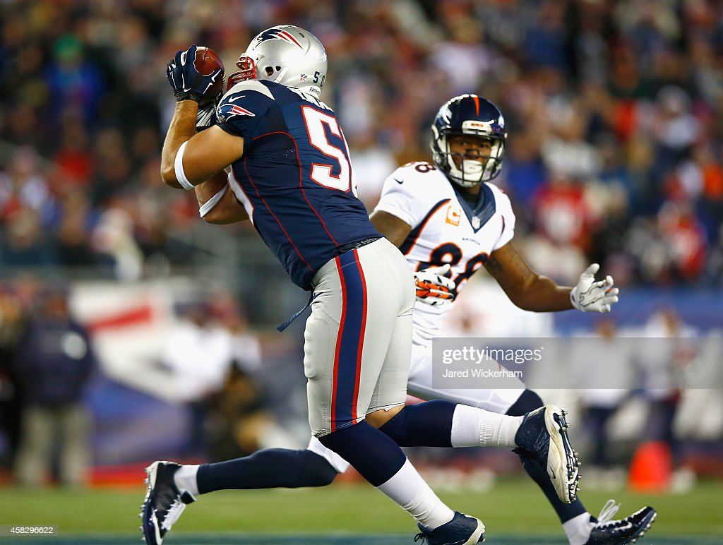 Rob Ninkovich of the New England Patriots intercepts a pass during the second quarter against the Denver Broncos at Gillette Stadium on November 2...