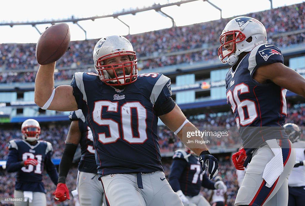 Rob Ninkovich #50 of the New England Patriots reacts after recovering a fumble and scoring a touchdown during the second quarter against the Chicago Bears at Gillette Stadium on October 26, 2014 in Foxboro, Massachusetts.