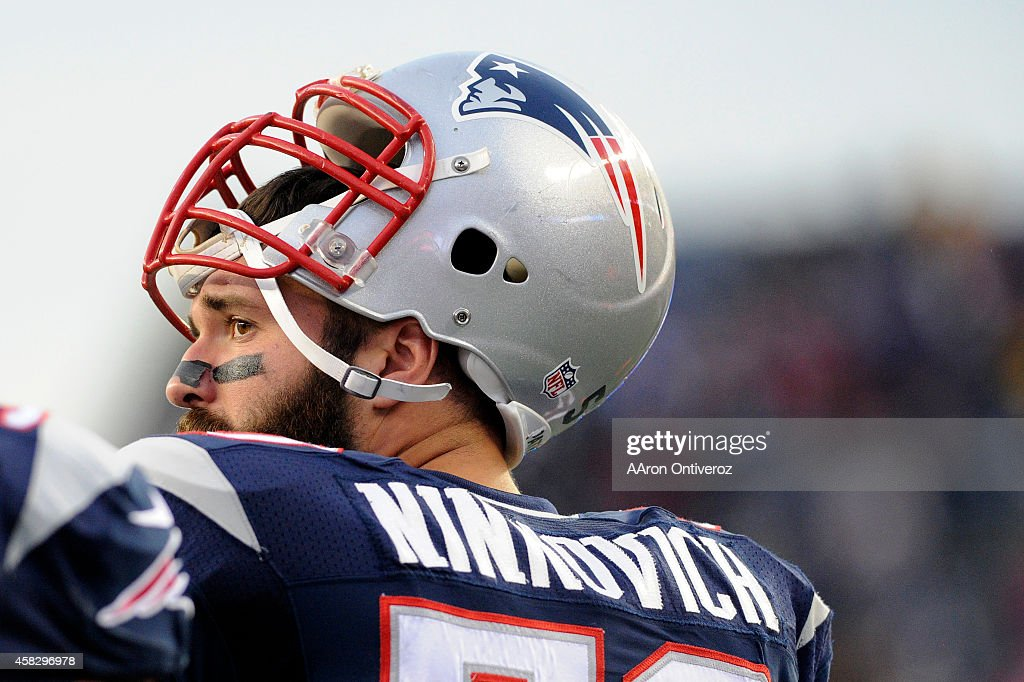 Rob Ninkovich of the New England Patriots stands on the field before taking on the Denver Broncos during the first half of action at Gillette Stadium...