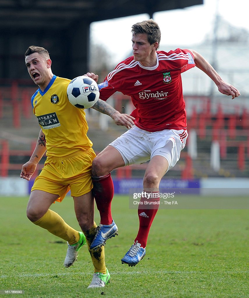 Rob Ogleby of Wrexham (R) clashes with Craig Nelthorpe of Gainsborough Trinity during the FA Trophy Semi-Final match between Wrexham and Gainsborough Trinity at the Racecourse Ground on February 16, 2013 in Wrexham, Wales.