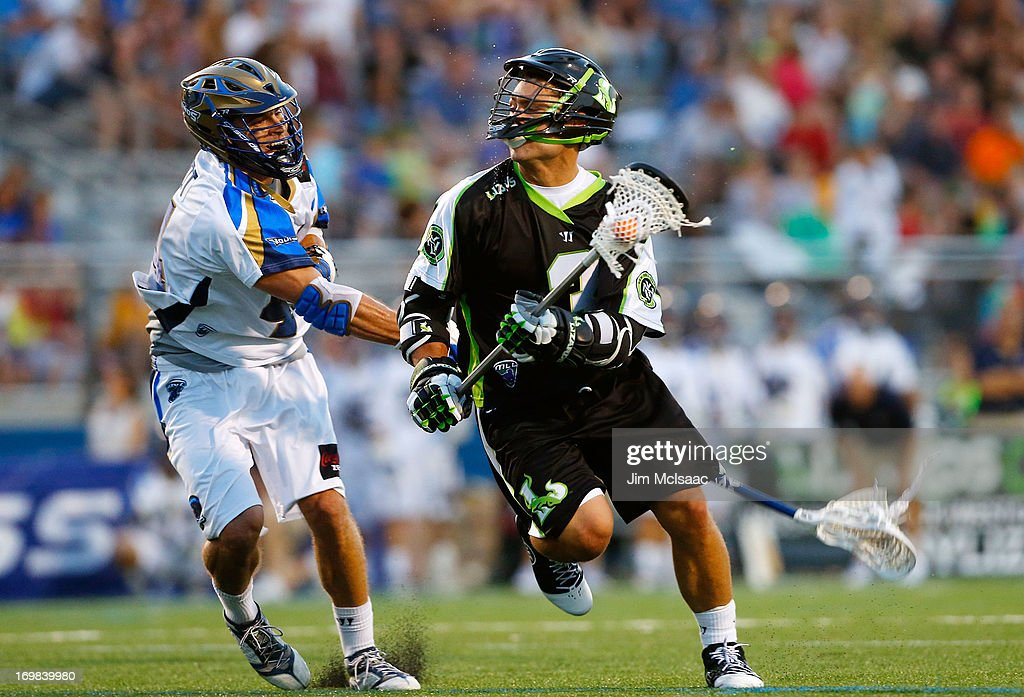 Rob Pannell #3 of the New York Lizards controls the ball in the second quarter against Brett Schmidt #44 of the Charlotte Hounds during their Major League Lacrosse game at Shuart Stadium on May 31, 2013 in Uniondale, New York.