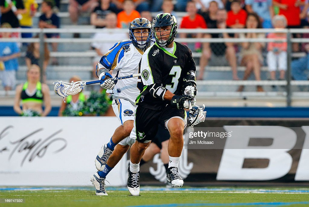 Rob Pannell #3 of the New York Lizards in action against Casey Cittadino #5 of the Charlotte Hounds during their Major League Lacrosse game at Shuart Stadium on May 31, 2013 in Uniondale, New York. The Hounds defeated the Lizards 14-12.