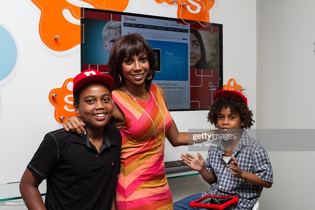 <Rob Peete, <a gi-track='captionPersonalityLinkClicked' href=/galleries/search?phrase=Holly+Robinson+Peete&family=editorial&specificpeople=213716 ng-click='$event.stopPropagation()'>Holly Robinson Peete</a>, and Roman Peete> gather for a donation on behalf of nabi to the HollyRod Foundation to help families living with autism at Fuhu, Inc. on April 7, 2013 in Los Angeles, California.