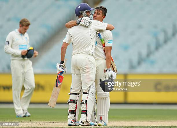 Rob Quiney and Marcus Stoinis of Victoria embrace as they win the match during day four of the Sheffield Shield match between Victoria and New South...