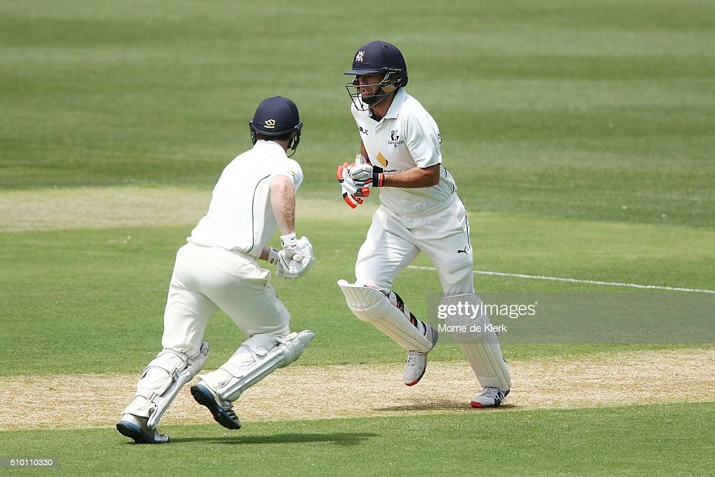 Rob Quiney and Travis Dean of the VIC Bushrangers runs between the wickets during day one of the Sheffield Shield match between South Australia and Victoria at Adelaide Oval on February 14, 2016 in Adelaide, Australia.