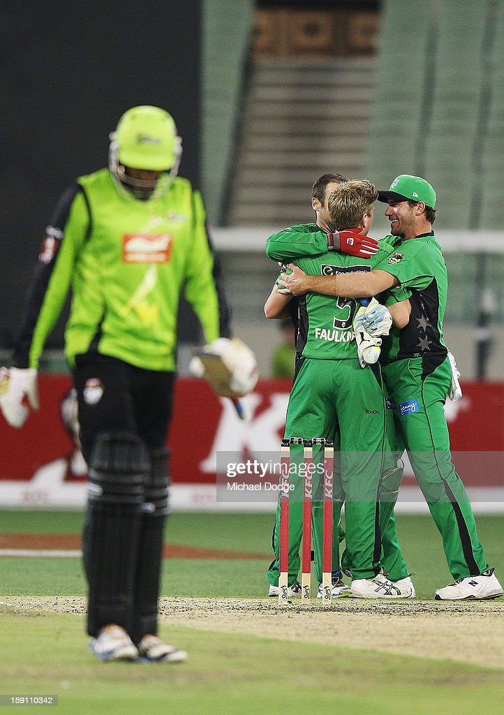 Rob Quiney, James Faulkner and John Hastings of the Melbourne Stars celebrate their win during the Big Bash League match between the Melbourne Stars and the Sydney Thunder at Melbourne Cricket Ground on January 8, 2013 in Melbourne, Australia.
