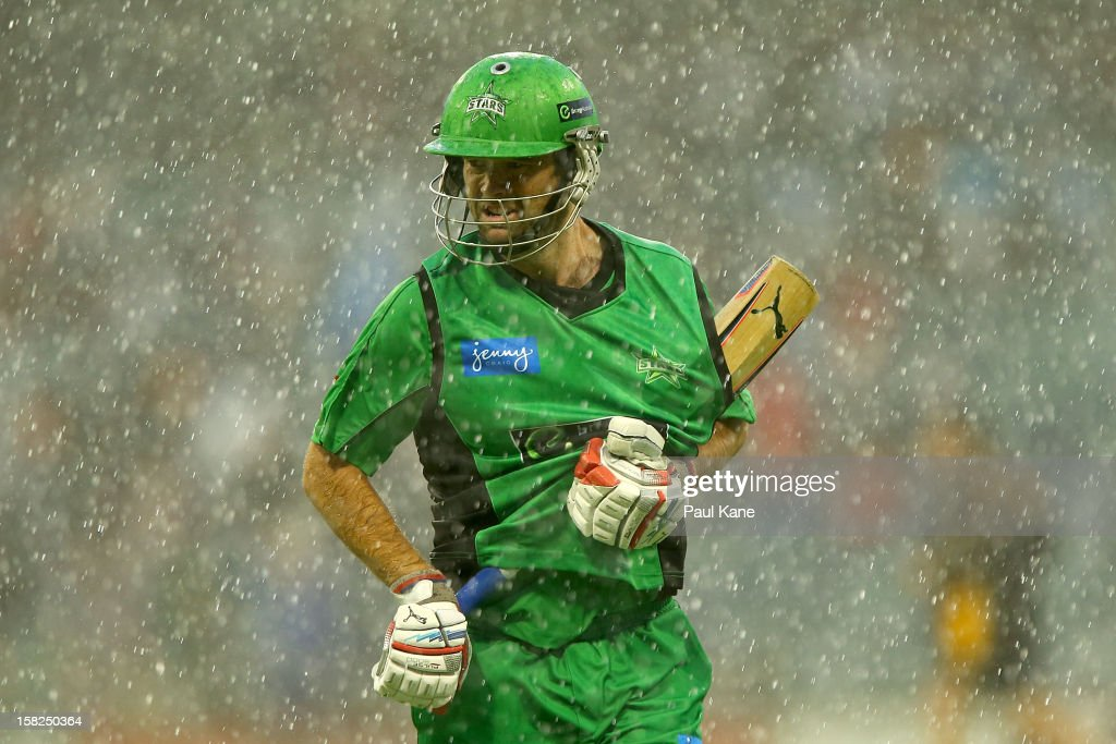 Rob Quiney of the Stars heads from the field as heavy rain sets in during the Big Bash League match between the Perth Scorchers and the Melbourne Stars at WACA on December 12, 2012 in Perth, Australia.