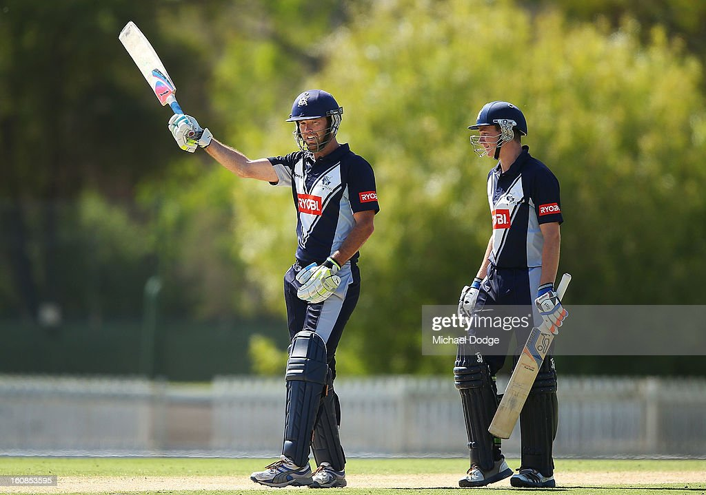 Rob Quiney of Victoria celebrates making a century next to Peter Handscomb during the International tour match between the Victorian 2nd XI and the England Lions at Junction Oval on February 7, 2013 in Melbourne, Australia.