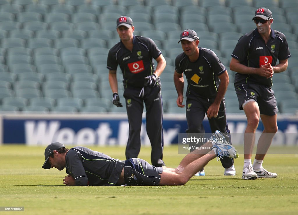 Rob Quiney takes a catch while Michael Clarke, <a gi-track='captionPersonalityLinkClicked' href=/galleries/search?phrase=Ricky+Ponting&family=editorial&specificpeople=176564 ng-click='$event.stopPropagation()'>Ricky Ponting</a> and <a gi-track='captionPersonalityLinkClicked' href=/galleries/search?phrase=Michael+Hussey&family=editorial&specificpeople=171690 ng-click='$event.stopPropagation()'>Michael Hussey</a> looks on during an Australian training session at Adelaide Oval on November 20, 2012 in Adelaide, Australia.