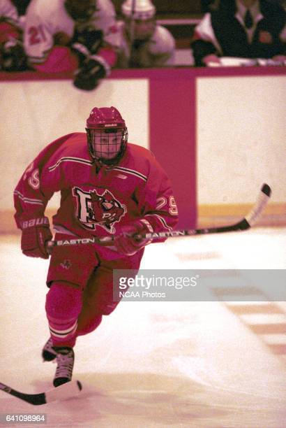 Rob Retter of Plattsburg State University skates down ice during the 2001 NCAA Men's Ice Hockey Championship held at Ritter Memorial Arena in...