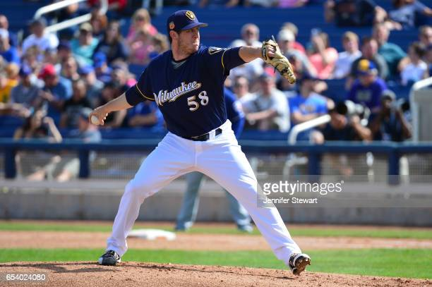 Rob Scahill of the Milwaukee Brewers delivers a pitch against the Texas Rangers in the spring training game at Maryvale Baseball Park on March 4 2017...