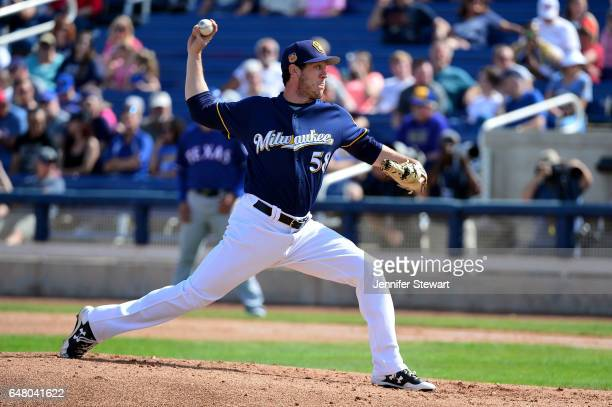 Rob Scahill of the Milwaukee Brewers delivers a pitch in the spring training game against the Texas Rangers at Maryvale Baseball Park on March 4 2017...