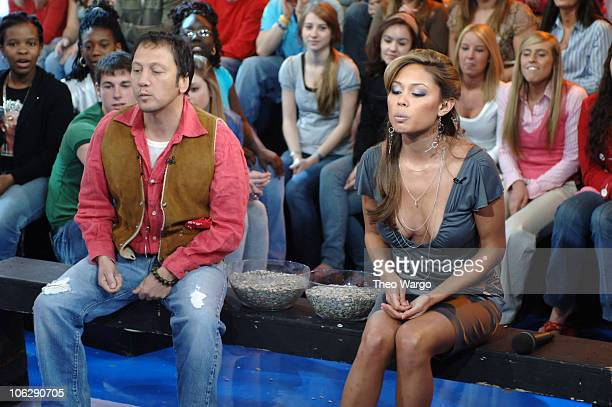Rob Schneider and Vanessa Minnillo have a sunflower seed spitting contest