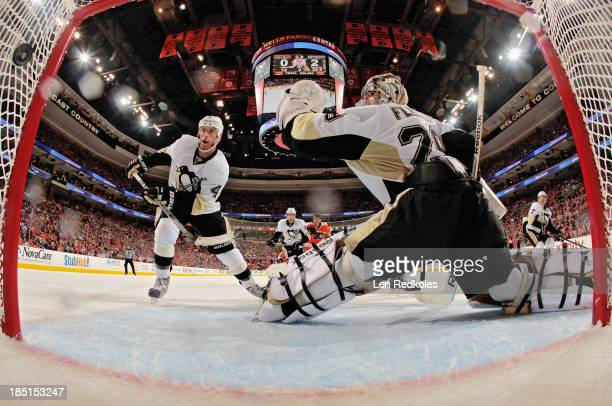 Rob Scuderi and MarcAndre Fleury of the Pittsburgh Penguins watch as Wayne Simmonds of the Philadelphia Flyers scores a second period powerplay goal...