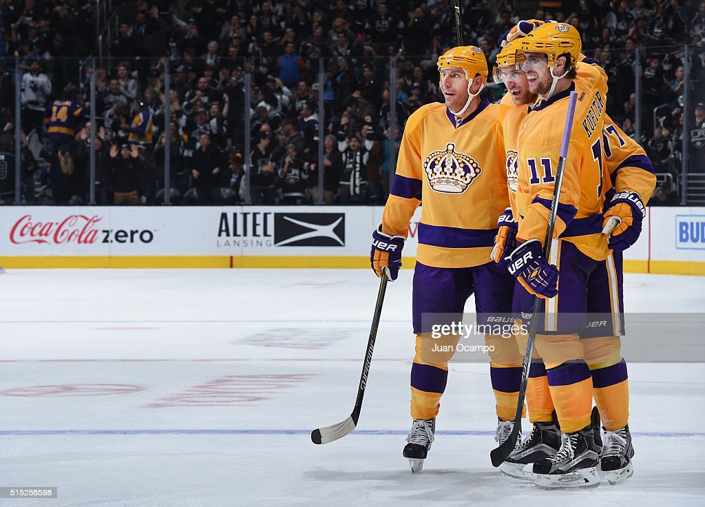 Rob Scuderi Jeff Carter and Anze Kopitar of the Los Angeles Kings celebrate a goal against the Vancouver Canucks on March 7 2016 at Staples Center in...