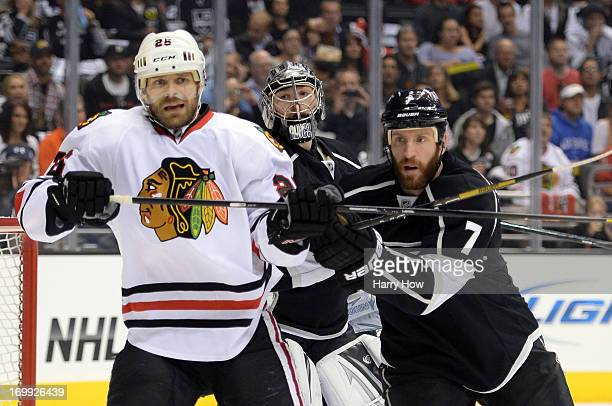 Rob Scuderi of the Los Angeles Kings and Michal Handzus of the Chicago Blackhawks vie for position in the low slot area as goaltender Jonathan Quick...
