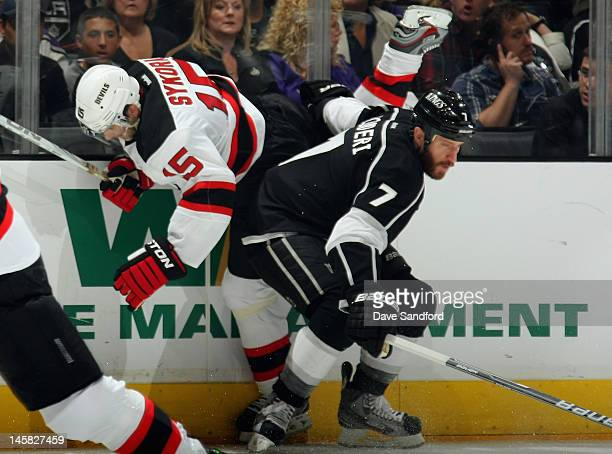 Rob Scuderi of the Los Angeles Kings checks Petr Sykora of the New Jersey Devils during the first period of Game Four of the 2012 Stanley Cup Final...
