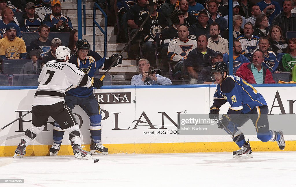 <a gi-track='captionPersonalityLinkClicked' href=/galleries/search?phrase=Rob+Scuderi&family=editorial&specificpeople=228124 ng-click='$event.stopPropagation()'>Rob Scuderi</a> #7 of the Los Angeles Kings defends against <a gi-track='captionPersonalityLinkClicked' href=/galleries/search?phrase=Alexander+Steen&family=editorial&specificpeople=600136 ng-click='$event.stopPropagation()'>Alexander Steen</a> #20 of the St. Louis Blues as Andy McDonald #10 skates for the puck in Game Two of the Western Conference Quarterfinals during the 2013 NHL Stanley Cup Playoffs on May 2, 2013 at Scottrade Center in St. Louis, Missouri.