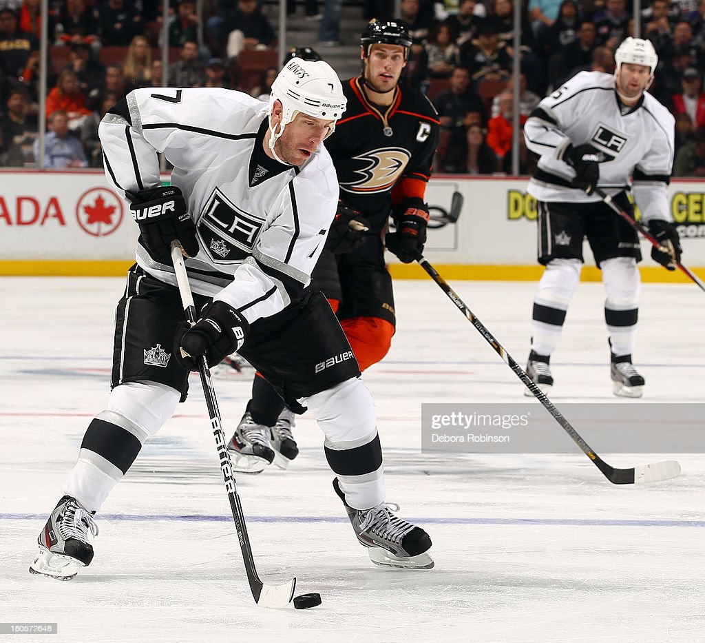 <a gi-track='captionPersonalityLinkClicked' href=/galleries/search?phrase=Rob+Scuderi&family=editorial&specificpeople=228124 ng-click='$event.stopPropagation()'>Rob Scuderi</a> #7 of the Los Angeles Kings handles the puck against <a gi-track='captionPersonalityLinkClicked' href=/galleries/search?phrase=Ryan+Getzlaf&family=editorial&specificpeople=602655 ng-click='$event.stopPropagation()'>Ryan Getzlaf</a> #15 of the Anaheim Ducks on February 2, 2013 at Honda Center in Anaheim, California.