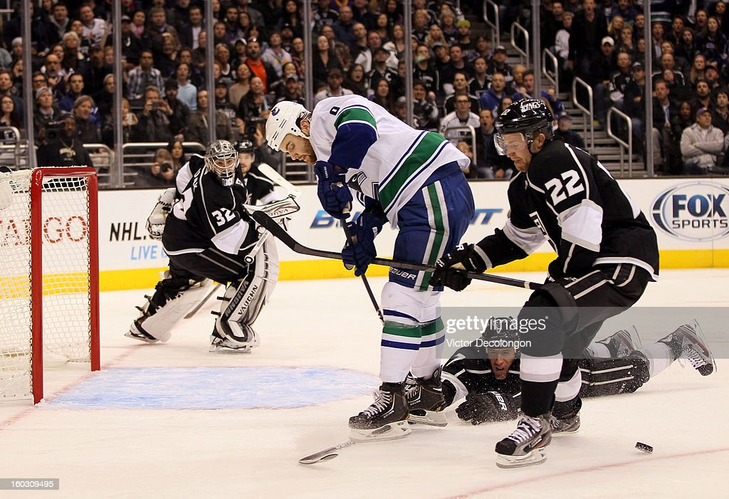<a gi-track='captionPersonalityLinkClicked' href=/galleries/search?phrase=Rob+Scuderi&family=editorial&specificpeople=228124 ng-click='$event.stopPropagation()'>Rob Scuderi</a> #7 of the Los Angeles Kings pokes the puck from the stick of <a gi-track='captionPersonalityLinkClicked' href=/galleries/search?phrase=Zack+Kassian&family=editorial&specificpeople=4604939 ng-click='$event.stopPropagation()'>Zack Kassian</a> #9 of the Vancouver Canucks to clinch prevent a scoring chance as goaltender <a gi-track='captionPersonalityLinkClicked' href=/galleries/search?phrase=Jonathan+Quick&family=editorial&specificpeople=2271852 ng-click='$event.stopPropagation()'>Jonathan Quick</a> #32 of the Los Angeles Kings is caught out of position during the NHL game at Staples Center on January 28, 2013 in Los Angeles, California. The Kings defeated the Canucks 3-2 in shootout overtime. The Kings defeated the Canucks 3-2 in shootout overtime.